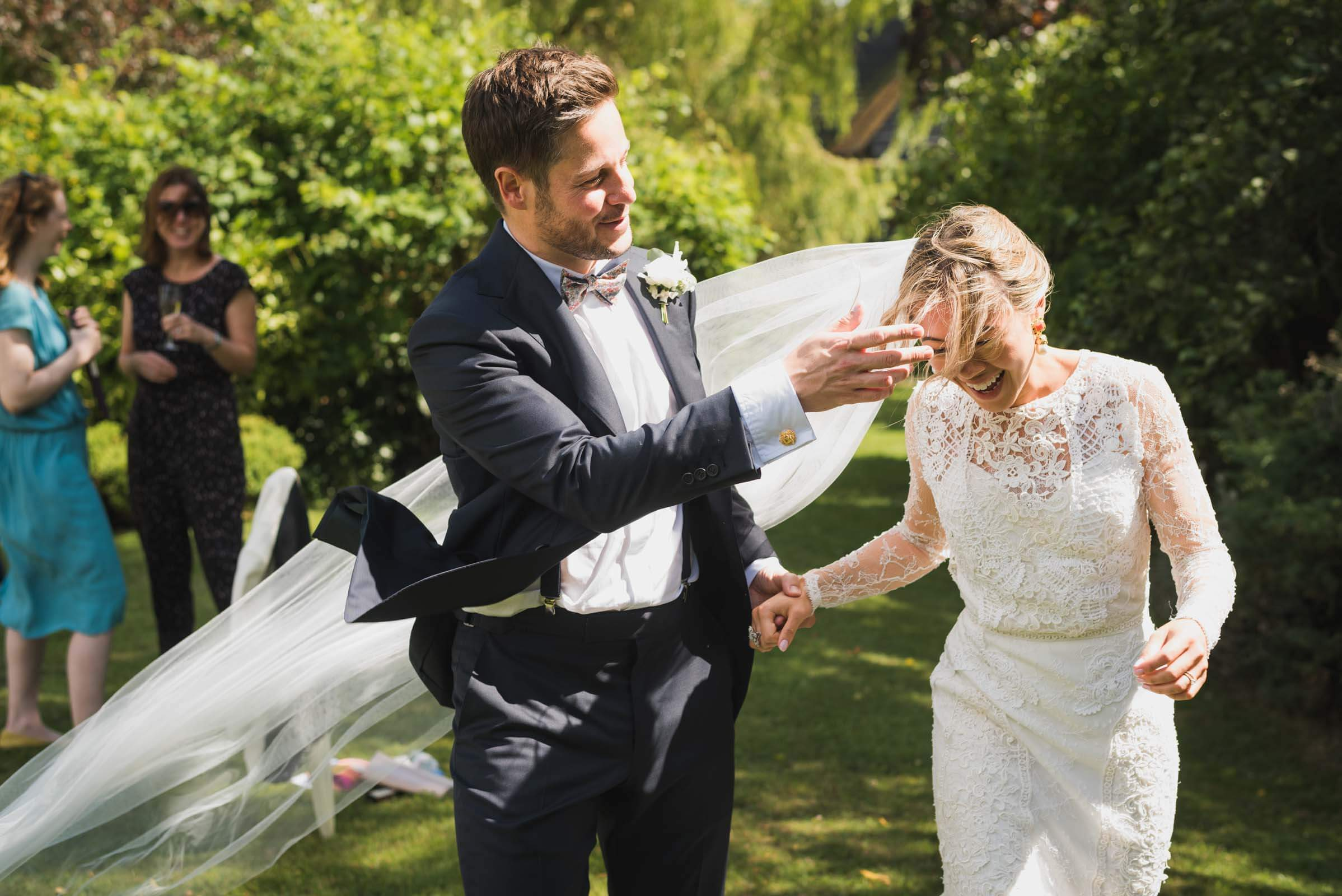 funny wedding couple at garden, Carine Bea Photography