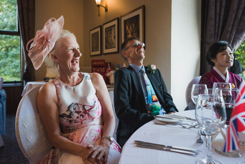 laughing at wedding