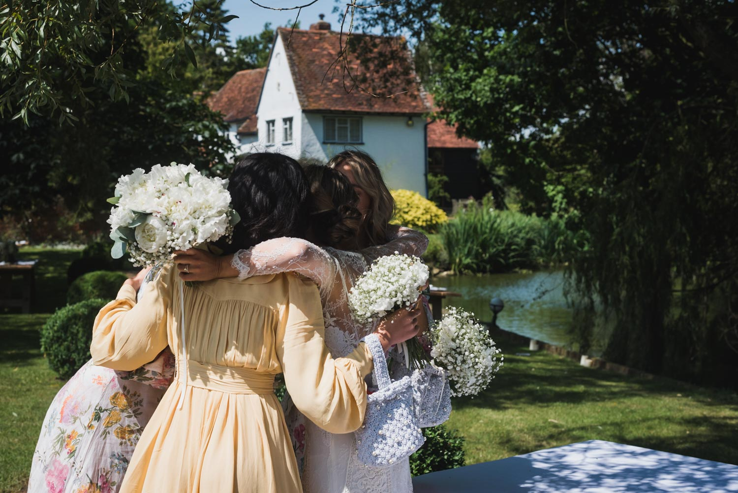 wedding hugs at garden, Carine Bea Photography