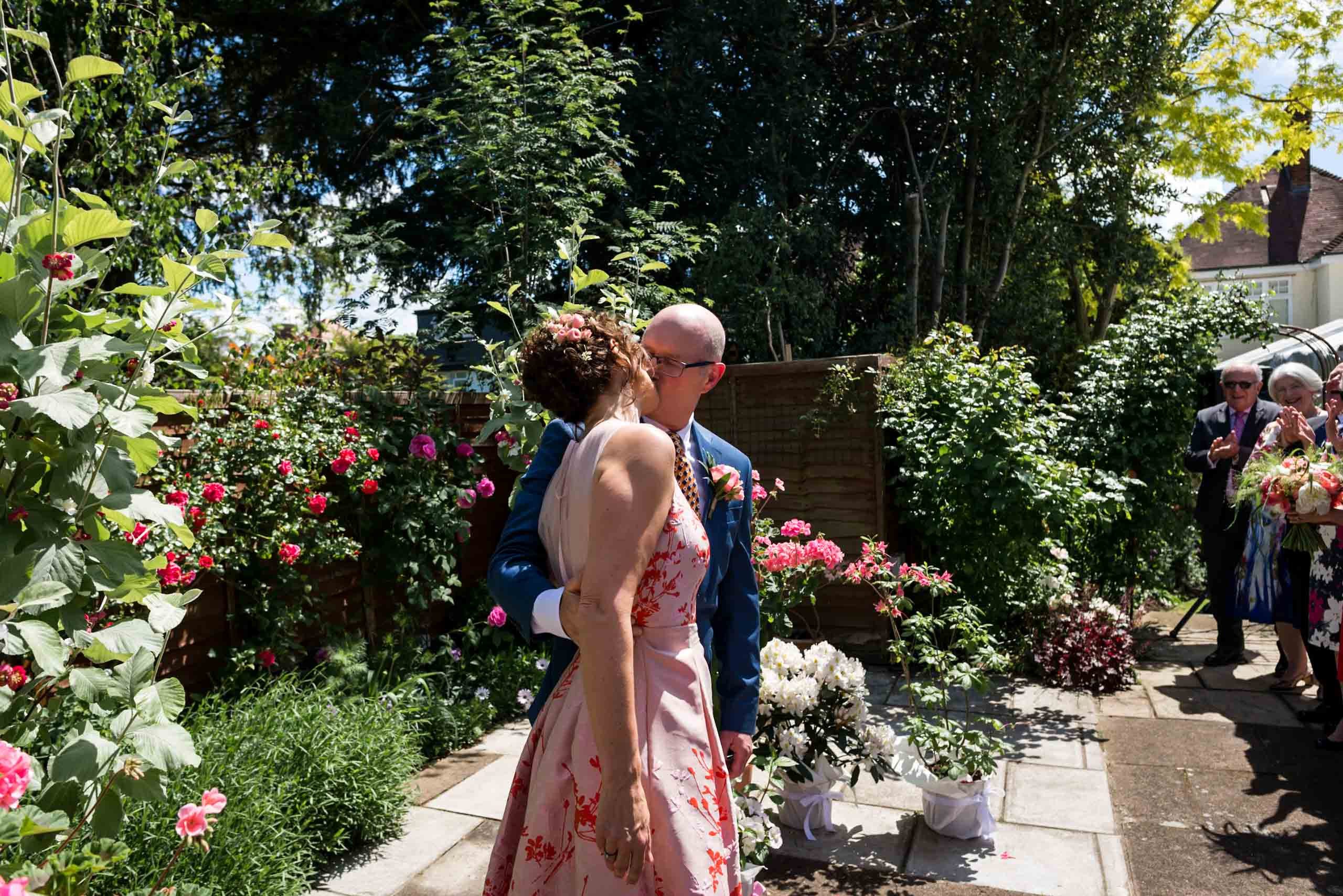 Carine Bea Photography, First kiss at back garden wedding in London