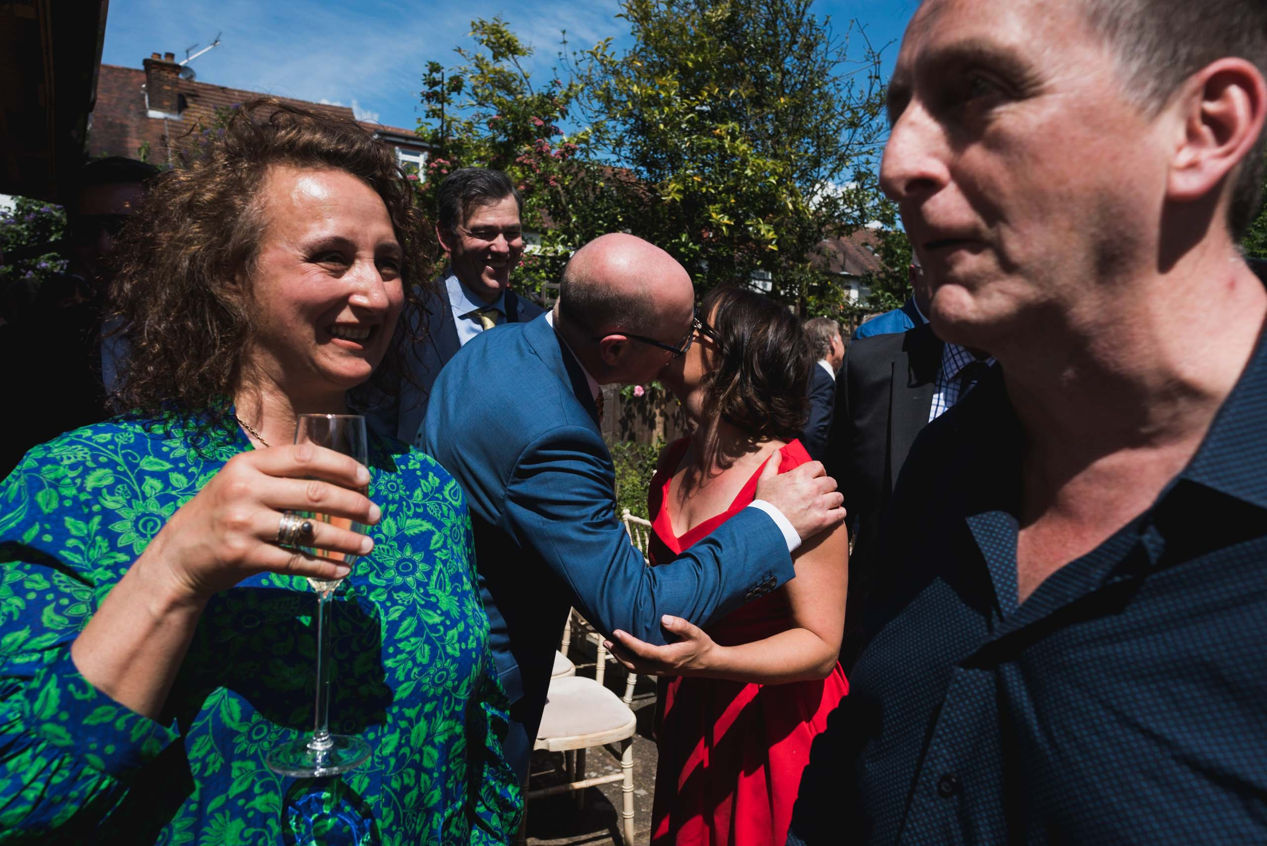 carine bea photography, guest in a wedding at back garden, documentary photographer