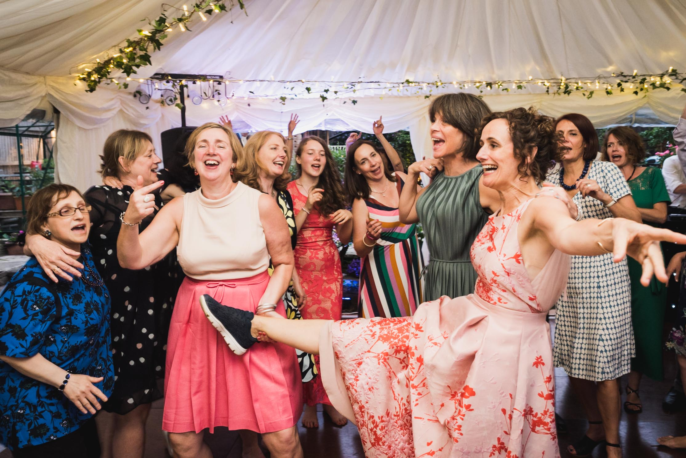 carine bea photography, bride having fun at back garden wedding