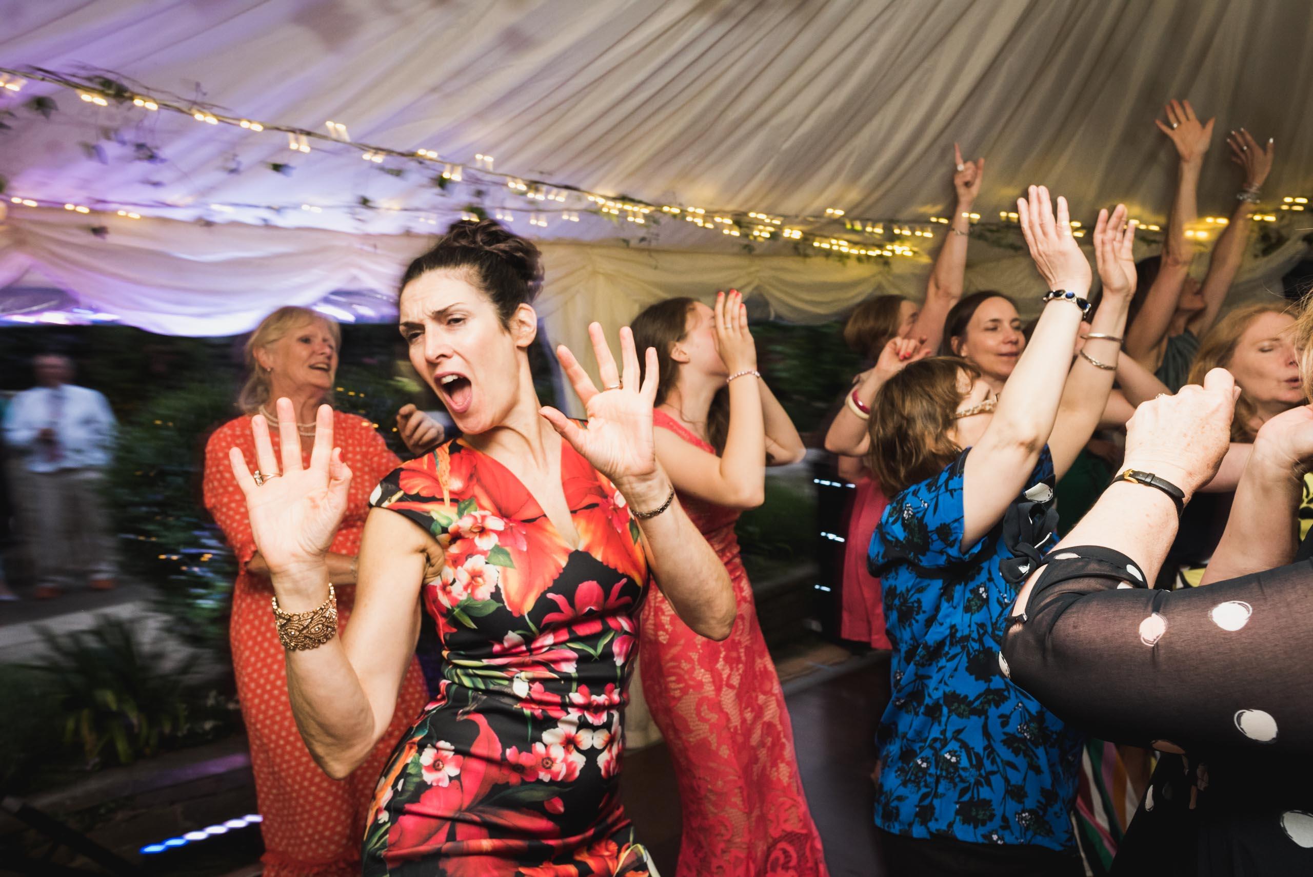 carine bea photography, guests having fun at back garden wedding