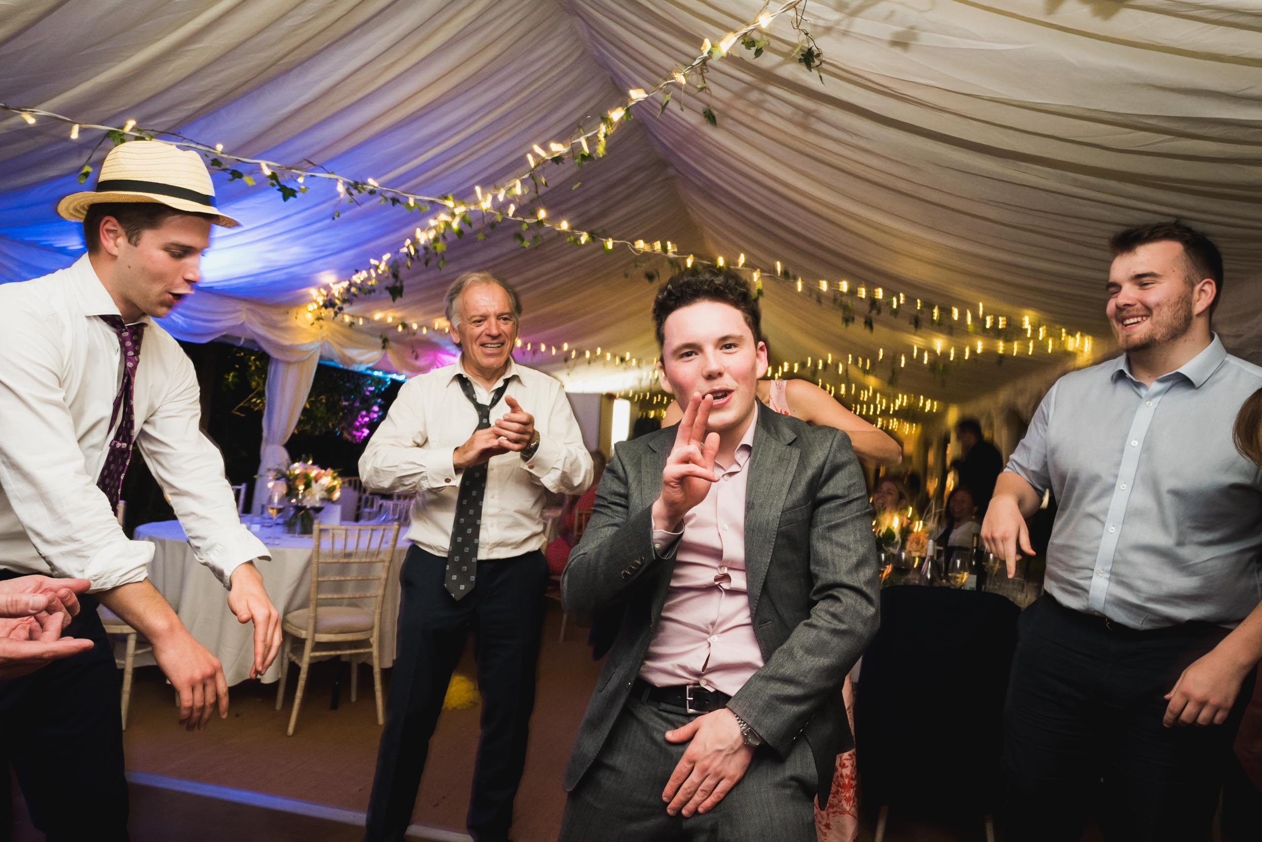carine bea photography, guests having fun at back garden wedding
