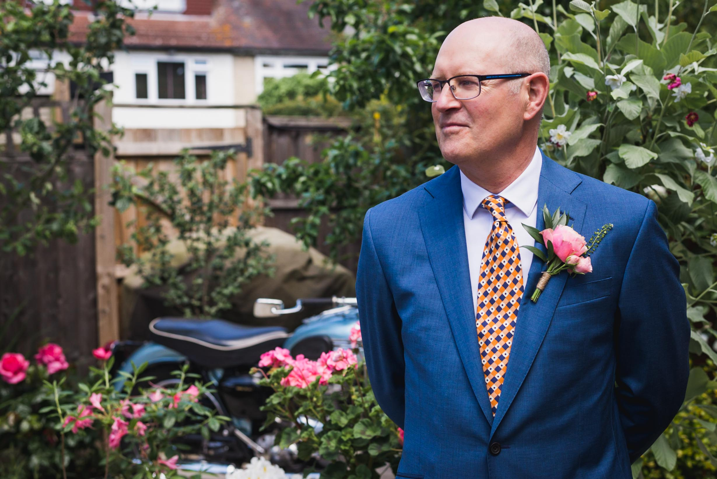 Carine Bea Photography, groom waiting for the bride at back garden wedding