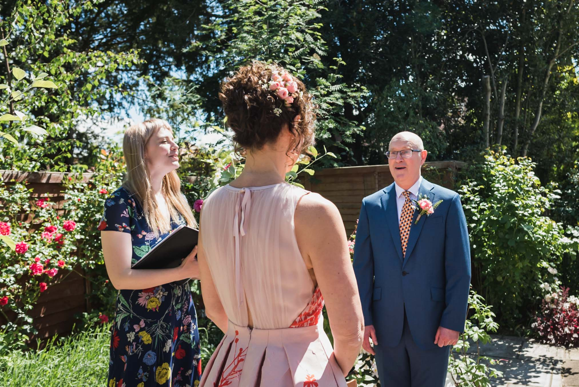carine bea photography, groom first look at bride in back garden wedding