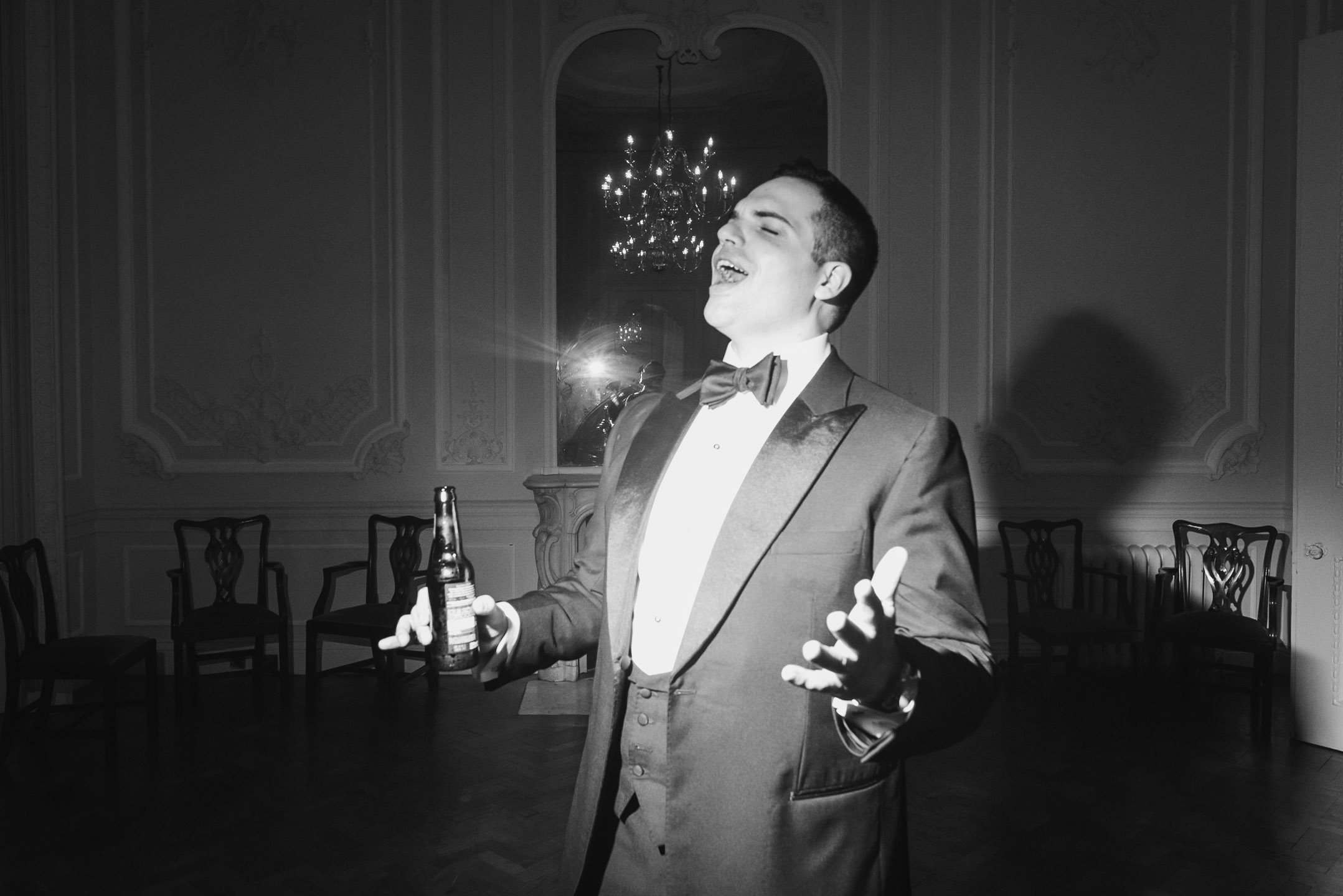 carine bea photography, groom having fun wedding Carlton House Terrace London