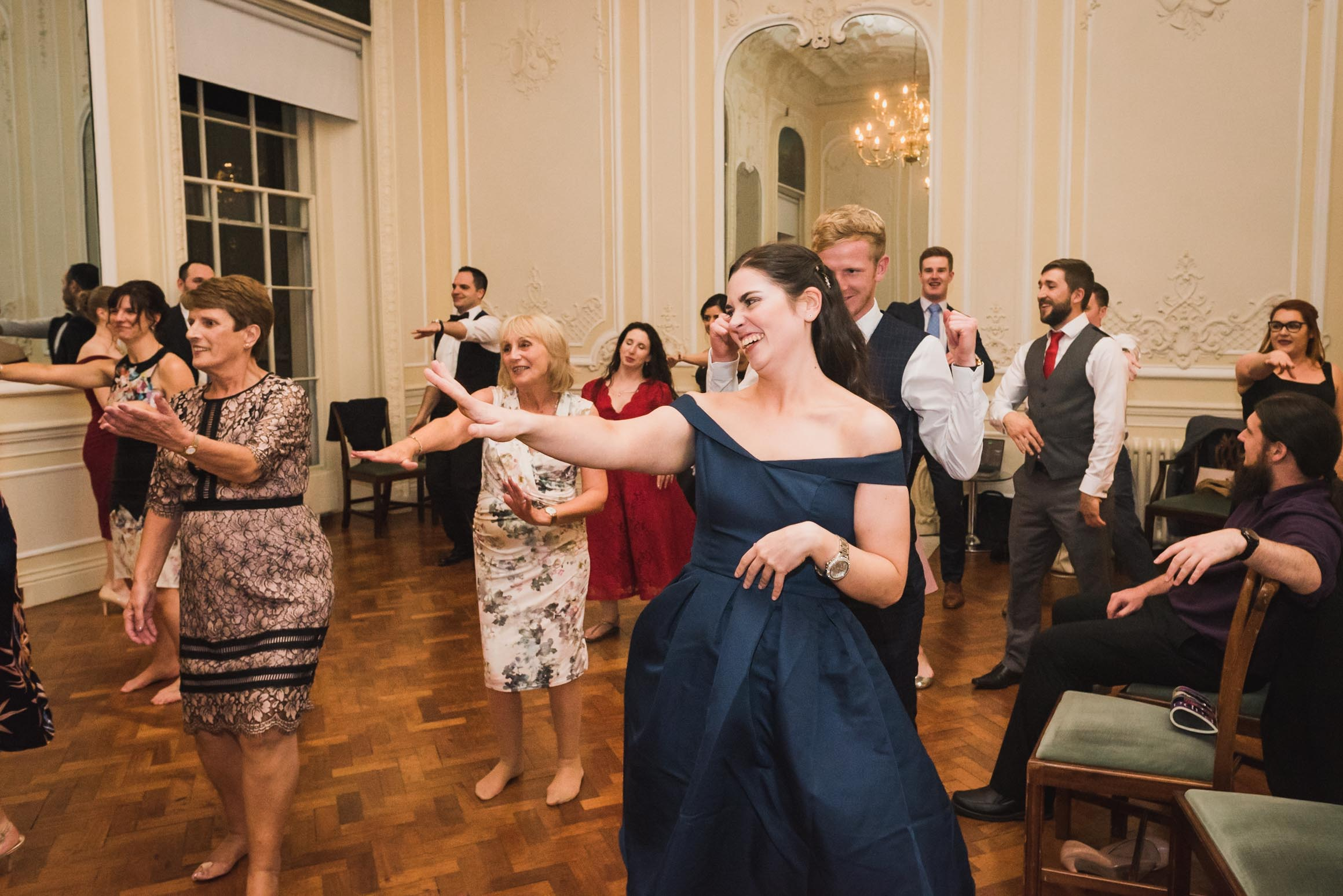 carine bea photography, guests having fun at wedding Carlton House Terrace London