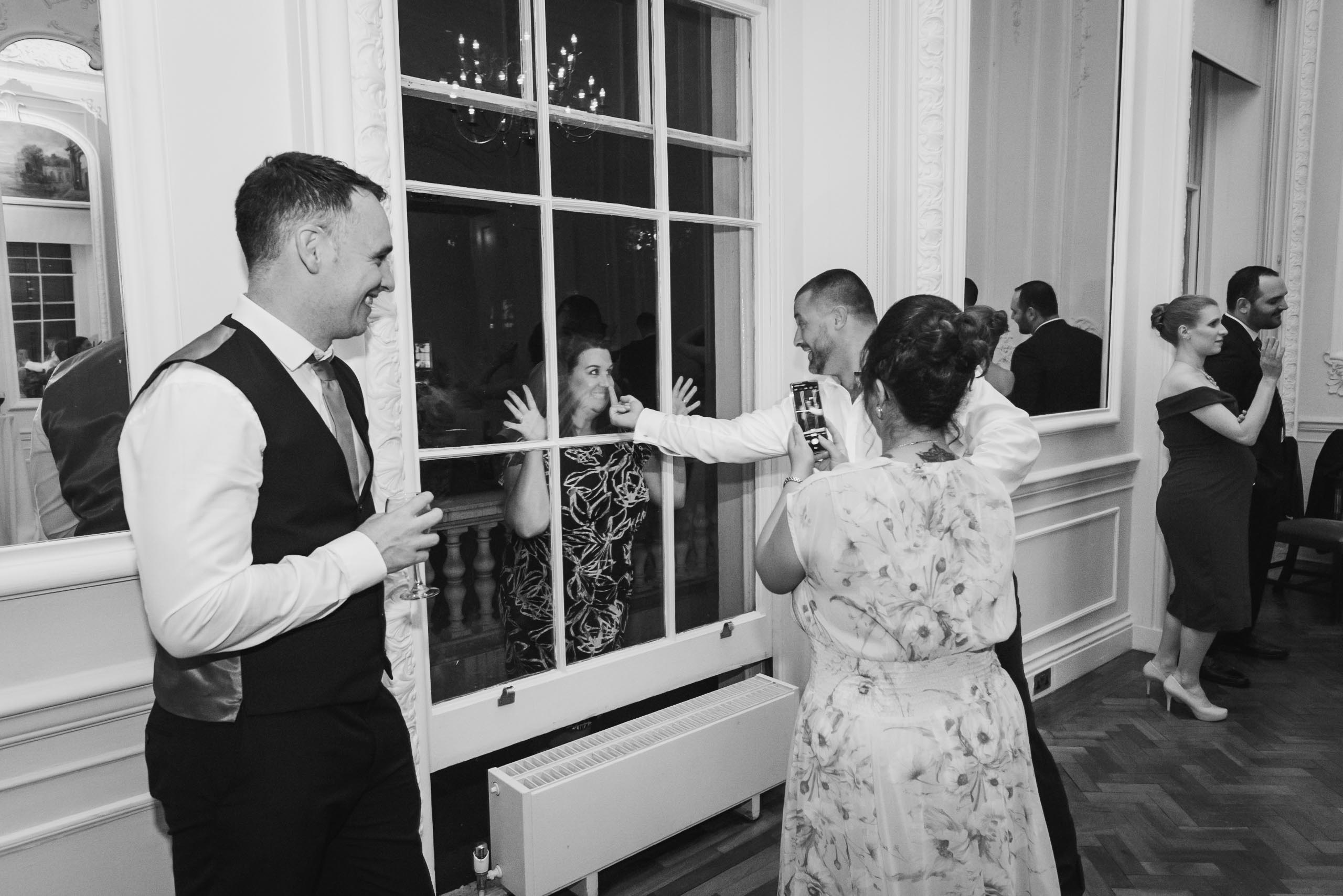 carine bea photography, silly face at wedding Carlton House Terrace London